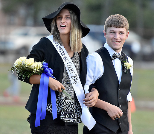 (Brad Davis/The Register-Herald) Shady Spring homecoming queen Sarah Crook and escort Sam Buckland's reaction at the announcement Saturday afternoon.