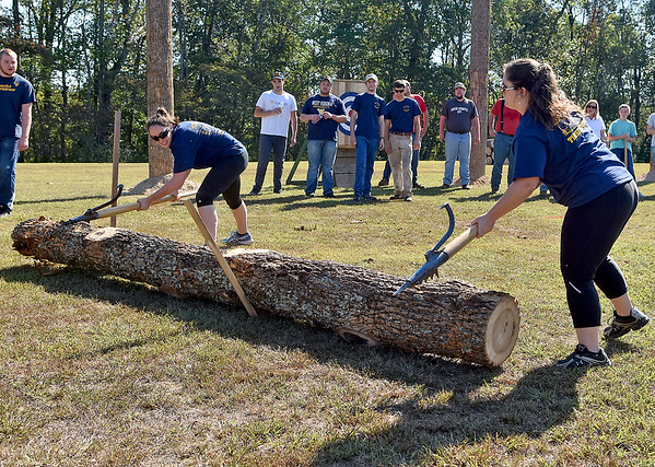 (Brad Davis/The Register-Herald) WVU Forestry students Rene Miller, left, and Britani Chambers compete in the women's log roll event during the 34th Annual Lumberjackin' Bluegrassin' Jamboree Saturday morning at Twin Falls Resort State Park.