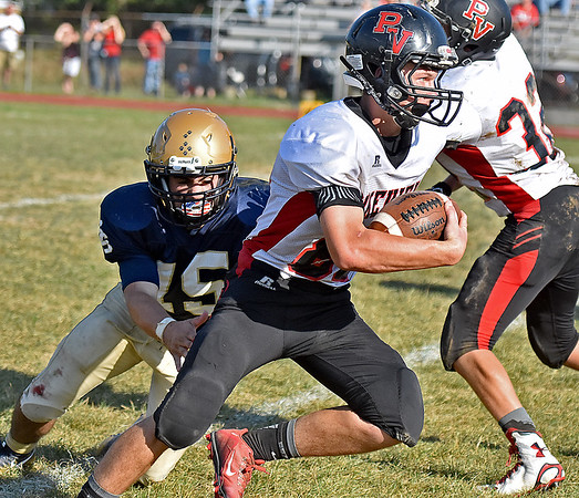 (Brad Davis/The Register-Herald) PikeView's Brian Keen eludes Shady Spring defender Tyler Bragg during the Tigers' homecoming game win over the Panthers Saturday afternoon.