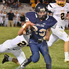 (Brad Davis/The Register-Herald) Greenbrier West running back Dakota Feamster is caught and tackled by Buffalo's Stephen Booth Friday night in Charmco.