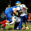 Midland Trail's Noah Minor (84) is brought down by Van's Alexander Gibson (9) and Brady Gran (21) during the second quarter of their football game Friday in Hico. (Chris Jackson/The Register-Herald)