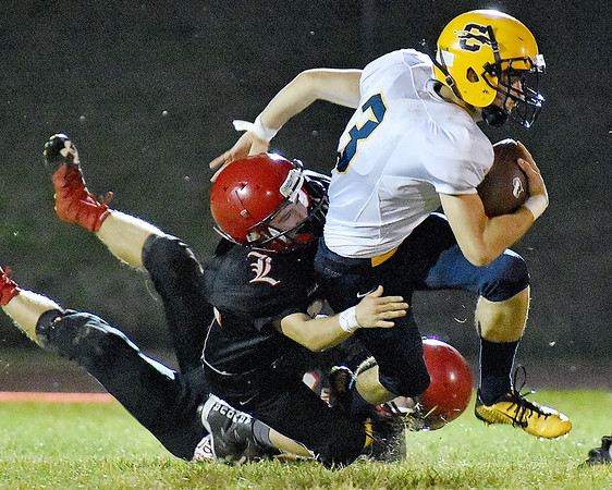 (Brad Davis/The Register-Herald) Liberty's Dalton Pettry takes down Clay County's Luke Young during the Raiders' win over the Panthers Friday night in Glen Daniel.