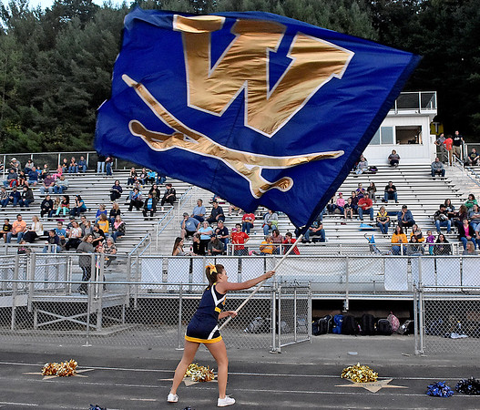 (Brad Davis/The Register-Herald) A Greenbrier West cheerleader waves a massive flag after Cavaliers score during their home game against Buffalo Friday night in Charmco.