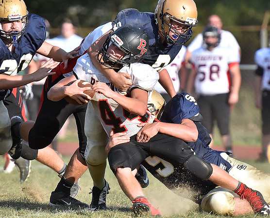 (Brad Davis/The Register-Herald) PikeView running back Evan Rose is stuffed late in the fourth quarter by Shady Spring defenders Gavin Turman, right, and Jaron Bragg, above, during the Tigers' homecoming game win over the Panthers Saturday afternoon.