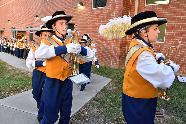 (Brad Davis/The Register-Herald) Greenbrier West band members begin their march from the school to the field prior to the Cavaliers' home game against Buffalo Friday night in Charmco.