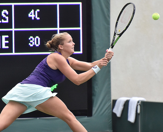 (Brad Davis/The Register-Herald) Shelby Rogers returns a ball during she and partner Pete Sampras' mixed doubles matchup against John McEnroe and Venus Williams during The Greenbrier Champions Tennis Classic Sunday afternoon in White Sulphur Springs.