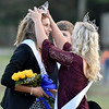 (Brad Davis/The Register-Herald) Shady Spring homecoming queen Sarah Crook, left, is crowned by last year's queen Madison Walker Saturday afternoon.