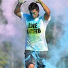 (Brad Davis/The Register-Herald) A runner is peppered by colored powder during the United Way of Sourthern West Virginia's Color Me United 5K Walk/Run Sunday afternoon at the Raleigh County Memorial Airport.