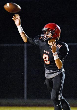 (Brad Davis/The Register-Herald) Liberty's Jacob Bailey throws against Clay County Friday night in Glen Daniel.