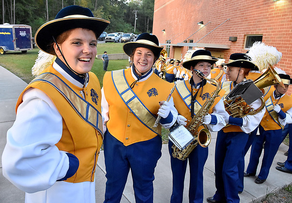 (Brad Davis/The Register-Herald) Greenbrier West band members notice the camera prior to beginning their march from the school to the field during the Cavaliers' home game against Buffalo Friday night in Charmco.