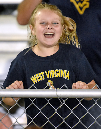 (Brad Davis/The Register-Herald) A young Greenbrier West fan chants and jumps along with Cavaliers' cheerleading squad during their game against Buffalo Friday night in Charmco.