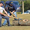 (Brad Davis/The Register-Herald) WVU Forestry students Jacob Gosnell, left, and J.T. Nicholson try to reposition the path of an extremely heavy log while competing in the men's log roll event during the 34th Annual Lumberjackin' Bluegrassin' Jamboree Saturday morning at Twin Falls Resort State Park. A team of WVU students came from Morgantown to take on a group of students and staff from Ohio State University in several lumber jack events, while vendors were on hand and live bluegrass shows commenced later in the day.