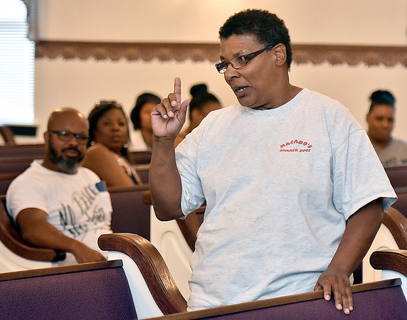 (Brad Davis/The Register-Herald) Concerned Beckley resident Nile Radford speaks during a community meeting and discussion on gun violence hosted by Moms Demand Action for Gun Sense in America Saturday afternoon at Heart of God Ministries.