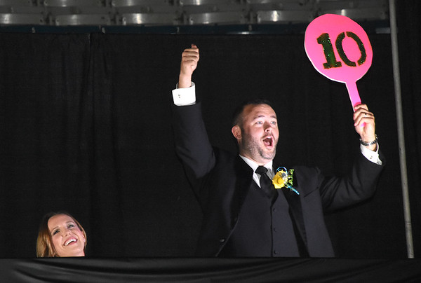 Matt Barber judge for the 5th Annual Dancing with the Stars event Friday evening at the Beckley Raleigh County Convention Center, holds up a 10 for Dr. Travis Wells and Debbie Sizemore's performance<br /> (Rick Barbero/The Register-Herald)