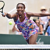 (Brad Davis/The Register-Herald) Venus Williams returns a ball during she and partner John McEnroe's mixed doubles matchup against Pete Sampras and Shelby Rogers during The Greenbrier Champions Tennis Classic Sunday afternoon in White Sulphur Springs.