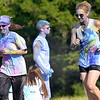 "(Brad Davis/The Register-Herald) Like many who ran or walked the event, Beckley Area Derby Dames Megan "" Rock it Like it's Hot"" Rock (left) and Felicity ""Sister Friction"" Ferri (right) were pretty caked with coloring as they got to the end of the Color Me United 5K Walk/Run Sunday afternoon."