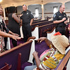 (Brad Davis/The Register-Herald) Concerned Beckley residents chat with city police officers and each other following a community meeting and discussion on gun violence hosted by Moms Demand Action for Gun Sense in America Saturday afternoon at Heart of God Ministries.