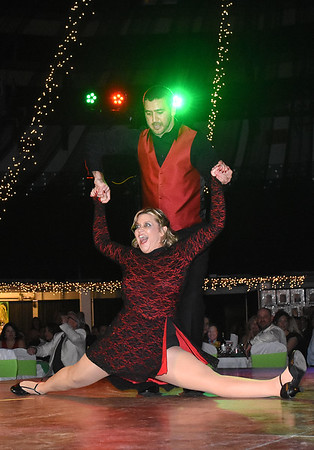 Rick Barbero/The Register-Herald<br /> Dr. Kyle Muscari and Andrea Mullins perform during the Dancing with the Stars event held at the Beckley-Raleigh County Convention Center Friday night.