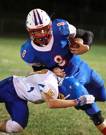 Midland Trail's Thomas Ferris (8) is tackled by a Van player during the second quarter of their football game Friday in Hico. (Chris Jackson/The Register-Herald)