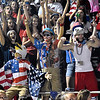 (Brad Davis/The Register-Herald) USA-themed Liberty students get rowdy following a Raiders touchdown against Clay County Friday night in Glen Daniel.
