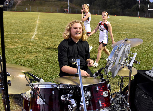 (Brad Davis/The Register-Herald) Liberty band member Tyler Carden chills out prior to the start of the Raiders' game against Clay County Friday night in Glen Daniel.