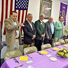 (Brad Davis/The Register-Herald) A group of 15 past presidents and district governors still living prepare for a group photo prior to a special dinner and ceremony honoring them at the Beaver Lions Club Thursday evening.