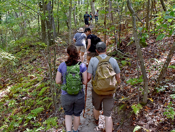 (Brad Davis/The Register-Herald) Hikers make their way along the Ship Rock Loop trail at the start of a hike to the old mill site led by members of Active Southern West Virginia Sunday afternoon at the YMCA Paul Cline Memorial Sports Complex. Ship Rock Trail is part of the new Grey Flats trail system developed by Gary Morefield and numerous volunteers.
