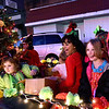 (Brad Davis/The Register-Herald) Youngsters (from left), Aria Sears, 4, Emileigh Carson, 10, and Falon Suttle, 10, react as they launch candy at any available target as they ride in a float during the annual Oak Hill Christmas Parade Saturday evening.