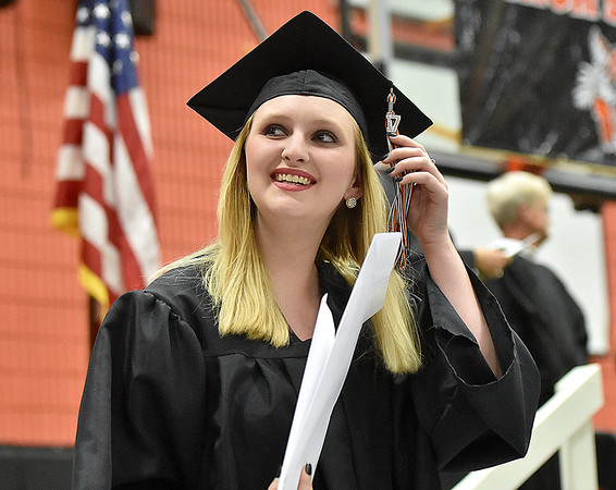 (Brad Davis/The Register-Herald) Summers County High School graduate Megan Adkins looks up towards cheering family after collecting her diploma during the school's commencement ceremony Friday evening in Hinton.