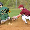 (Brad Davis/The Register-Herald) Greenbrier East's Daylon Colley steals 2nd base as Woodrow Wilson 2nd baseman Hunter Tolliver tries to make the tag during the Spartans' win over the Flying Eagles Monday evening.