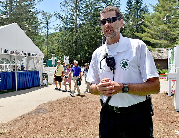 (Brad Davis/The Register-Herald) First aid worker Jeff Powell mans the first aid tent during the Greenbrier Classic Sunday afternoon in White Sulphur Springs.