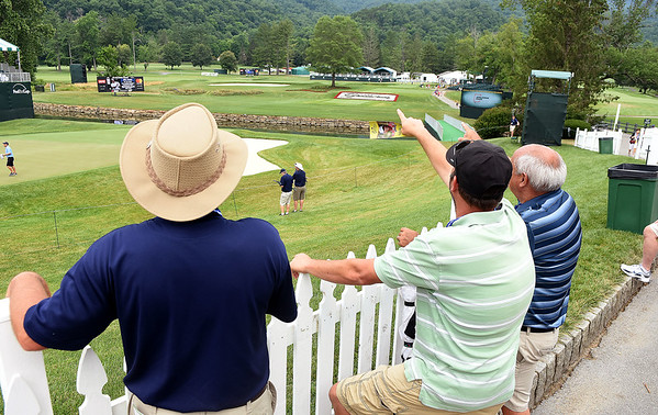 Spectators looking over the view of the 18th hole on the Old White Course at The Greenbrier during Youth Day for The Greenbrier Classic.<br /> (Rick Barbero/The Register-Herald)