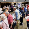 Seniors visiting a variety of booths during the Senior Day Out at the Beckley Raleigh County Convetion Center.<br /> (Rick Barbero/The Register-Herald)
