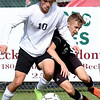 Jarred Johnson, of Pikeview, left, and Dylan Massey, of Oak Hill, go after the ball during the sectional final match held at the YMCA Paul Cline Memorial Youth Sports Complex. <br /> (Rick Barbero/The Register-Herald)