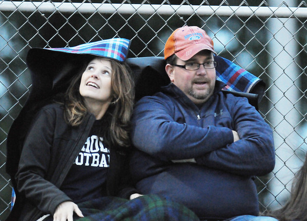 Two Nicholas County fans stay warm during their football game against Shady Spring Friday in Shady Spring.  (Chris Jackson/The Register-Herald)