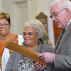 "(Brad Davis/The Register-Herald) Brenda Clements (middle), widow of the late Beckley firefighter Charles Clements, holds back tears as mayor Rob Rappold reads a special proclamation declaring February 26th ""Charles Clements Day"" in Beckley during Central Baptist Church's Black History Month celebration Sunday afternoon. Clements was the first African Amercian firefighter in Beckley and served over 20 years. He passed away in late January. Choir member Doris McCormick looks on at left."