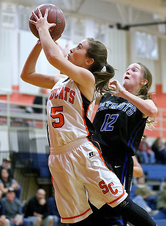 (Brad Davis/The Register-Herald) Summers County's Heaven Cales drives and scores past Midland Trail's defender Loretta Hypes Thursday night in Hinton.