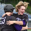 (Brad Davis/The Register-Herald) James Monroe's William Shiflet, left, and teammate Colton Bradley celebrate after Shiflet scored the game-winning run to beat Independence in the first of two games Friday afternoon at Linda K. Epling Stadium.
