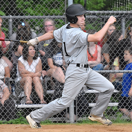 (Brad Davis/The Register-Herald) Wyoming East's Dylan Repass hits a ball in play off Independence starting pitcher Nick Kostenko Friday evening in Coal City.