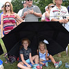 Bree Grose, 7, left, of Charleston, and Tinley Gruse, 5, of Roanoke, Va, shade themsleves from the sun on the 8th hole during the second round of The Greenbrier Classic.<br /> (Rick Barbero/The Register-Herlad)