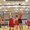 (Brad Davis/The Register-Herald) Special Olympics basketball teams from Raleigh County, dressed in red, and Fayette County, clad in orange, square off on the court inside Beckley's Van Meter Gymnasium during a local tournament Thursday evening. Both teams, comprised of both kids and adults ages 8 and up will be competing in the upcoming West Virginia Special Olympics state tournament and skills competition in Morgantown the weekend of March 11.