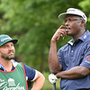Vijay Singh, right, thinks about his shot to hir on the 13th hole during the first round of The Greenbrier Classic.<br /> (Rick Barbero/The Register-Herald.com