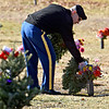 (Brad Davis/The Register-Herald) COL. Chris Selvey, a veteran and instructor of the Fayette County Army J.R.O.T.C. program, lays wreathes on every grave marker designated as a veteran's at High Lawn Memorial Park in Oak Hill during a Wreathes Across America ceremony Saturday afternoon.