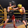 (Brad Davis/The Register-Herald) Robbie Belcher, right, takes on Hunter Billings in a middleweight matchup during Original Toughman action Saturday night at the Beckley-Raleigh County Convention Center. Billings would win the fight.