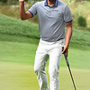 Sabastian Munoz waves to the crowd after sinking his birdie putt on the 13th hole during the third round of The Greenbrier Classic.<br /> (Rick Barbero/The Register-Herald)