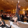 (Brad Davis/The Register-Herald) David Brooks during individual introductions at the annual Hunks in Heels fundraising event for the Women's Resource Center Friday night at the Beckley Moose Lodge.