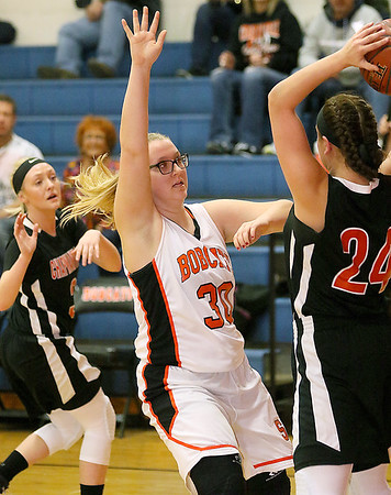 (Brad Davis/The Register-Herald) Summers County's Chloey Davis pressures Chapmanville's Kaylee Blair (#24) as she looks for an open teammate during the Lady Bobcats' win over the Tigers Saturday night in Hinton.