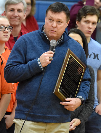 "(Brad Davis/The Register-Herald) Former Summers County Lady Bobcats basketball coach Wayne Ryan holds back tears as he gives a brief thank you speech during a court dedication ceremony in his name Friday night in Hinton. It will now be known as the ""Coach Wayne Ryan Court."""