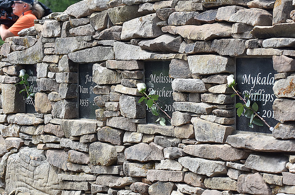 (Brad Davis/The Register-Herald) The newly dedicated Old Mill Park Flood Memorial bears the names of all White Sulphur Springs residents lost in last year's devasting floods.