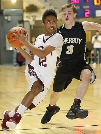 (Brad Davis/The Register-Herald) Woodrow Wilson's Josiah Walton speeds to the basket as University's Kaden Metheny defends during Big Atlantic Classic action Saturday night at the Beckley-Raleigh County Convention Center.